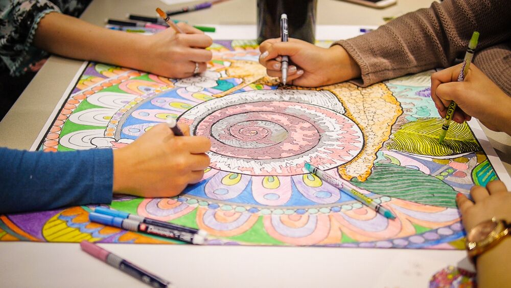Staff and volunteers at Loma Linda University Children's Hospital Coloring Mandalas with Mama Earth.